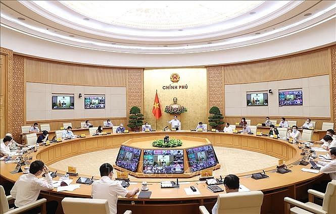 Quang cảnh cuộc họp tại điểm cầu Chính phủ. Ảnh: Dương Giang/TTXVN