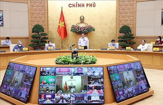 Thủ tướng Phạm Minh Chính phát biểu kết luận cuộc họp trực tuyến với các xã, phường một số địa phương đang thực hiện giãn cách xã hội. Ảnh: Dương Giang/TTXVN