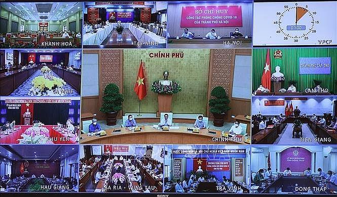 Cuộc họp tại điểm cầu các địa phương. Ảnh: Dương Giang/TTXVN